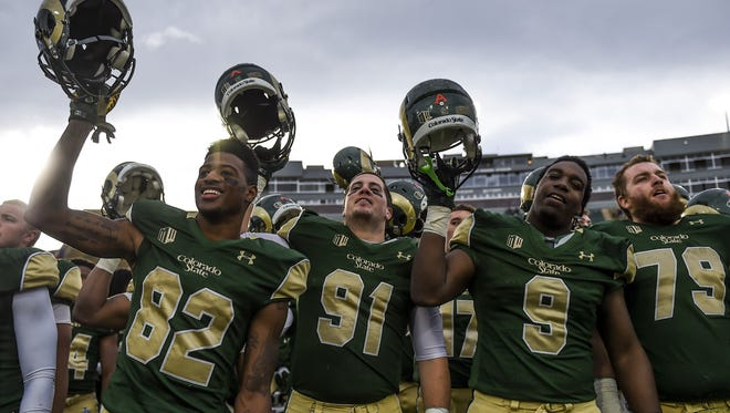 The CSU football team celebrates a 58-20 win over New Mexico Saturday, Nov. 22, at Hughes Stadium in Fort Collins, CO.