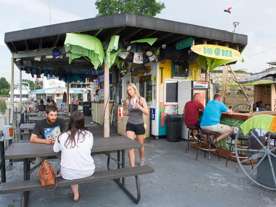 Patrons enjoy the weather at OV Tiki Time Bar and Grill is located at 1801 Waterworks Road, on LST 325 Drive. OV Tiki Time is an outside restaurant built on a barge that floats on the Ohio River.