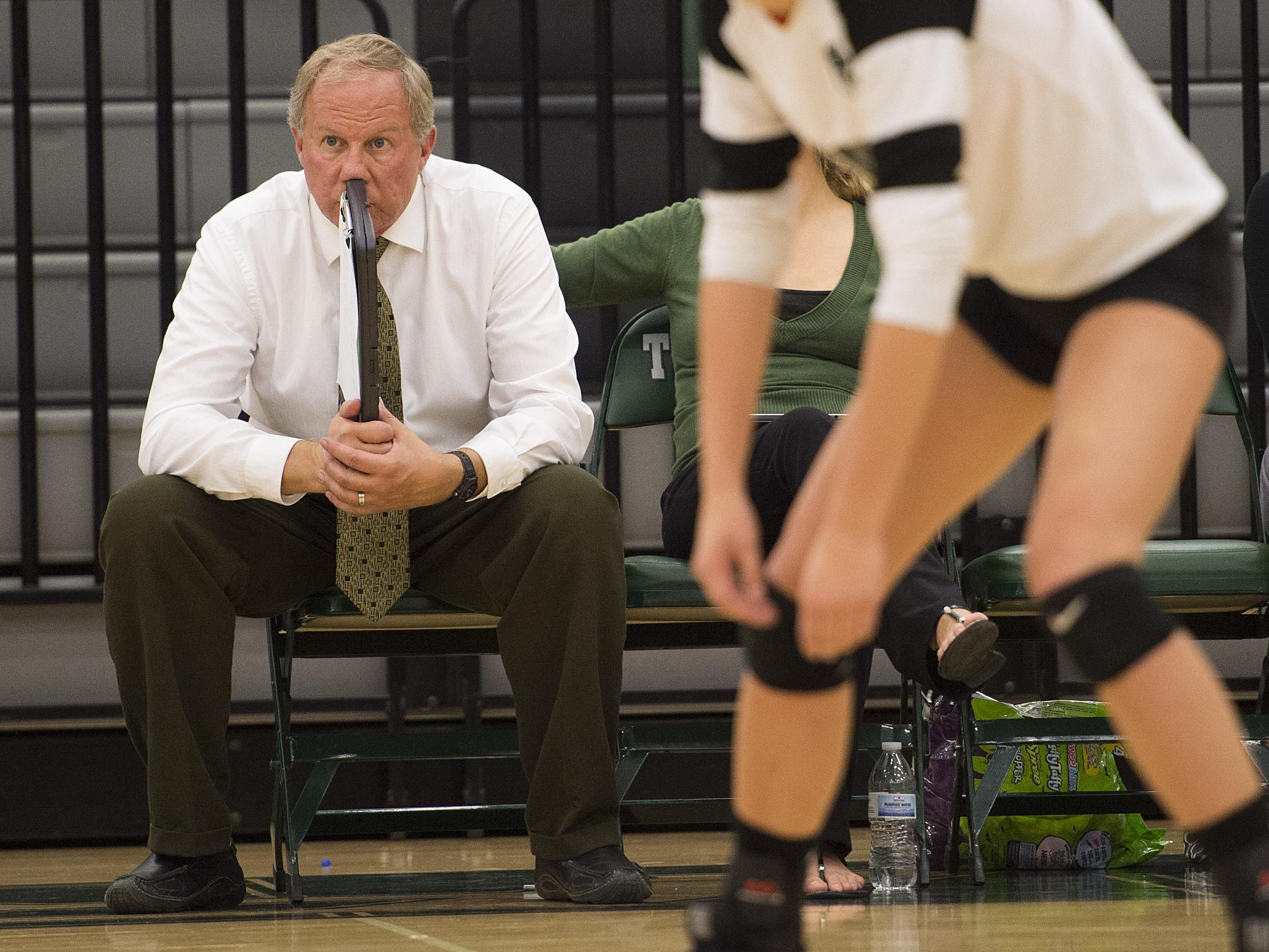 Fossil Ridge volleyball coach Paul Shimek watches his team in a file photo. The SaberCats moved up to No. 2 in the Class 5A volleyball rankings this week.