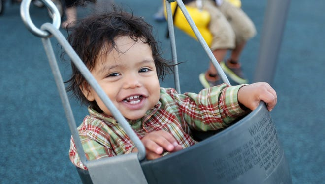 Ares Robinson, 1, swings during the grand opening of the Let's All Play Place on Thursday, Sept. 15, 2016, in Salem. The therapy and community play area is located at the corner of Mission Street SE and Church Street SE on the Salem Health campus.
