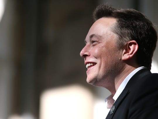 Tesla Motors CEO Elon Musk speaks at a press conference after Nevada was chosen as the new site for a $5 billion car battery gigafactory, which will be built east of Reno. Several hundred people attended the media event at the Capitol in Carson City, Nev., on Thursday, Sept. 4, 2014.