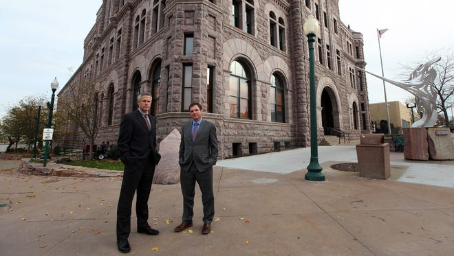 In the Oct. 27, 2015 photo, Assistant South Dakota U.S. Attorneys Kevin Koliner, right, and Jeff Clapper stand outside the Federal Building and United States Courthouse in Sioux Falls, S.D. Clapper and Koliner have prosecuted multiple sex trafficking cases in the state. Koliner says he's encountered young women who, after their trafficker is arrested, end up in another operation.