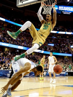 CLEVELAND, OH - MARCH 28:  Zach Auguste #30 of the Notre Dame Fighting Irish dunks over Andrew Harrison #5 of the Kentucky Wildcats in the second half during the Midwest Regional Final of the 2015 NCAA Men's Basketball tournament at Quicken Loans Arena on March 28, 2015 in Cleveland, Ohio.  (Photo by Andy Lyons/Getty Images)