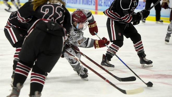 Norwich University senior Sarah Schwenzfeier operates in traffic during the first period of the Cadets' NCAA seminfinal game against Hamline University Friday.