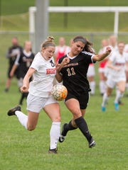 Brighton's Kayla Foran, left, and Northville's Ari Laba vie for control of the ball Thursday, May 3, 2018 at Brighton's Sloan Field.