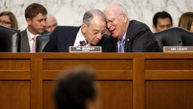 Senate Judiciary Committee Chairman Chuck Grassley, R-Iowa, listens to Sen. Patrick Leahy, D-Vt.