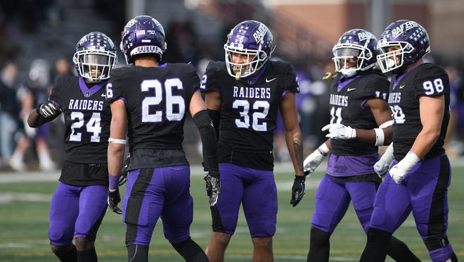 Mount Union football players gather during a 2019 playoff game against Hanover.