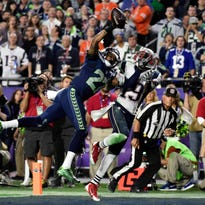 Seattle Seahawks cornerback Tharold Simon (27) breaks up a pass intended for New England Patriots wide receiver Brandon LaFell (19) in the fourth quarter in Super Bowl XLIX at University of Phoenix Stadium.