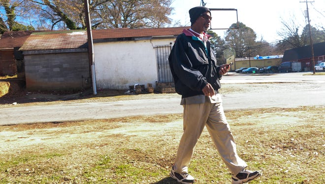 Eugene Thomas of Anderson walks by the Big D's Lounge on West Whitner Street in Anderson on Tuesday.
