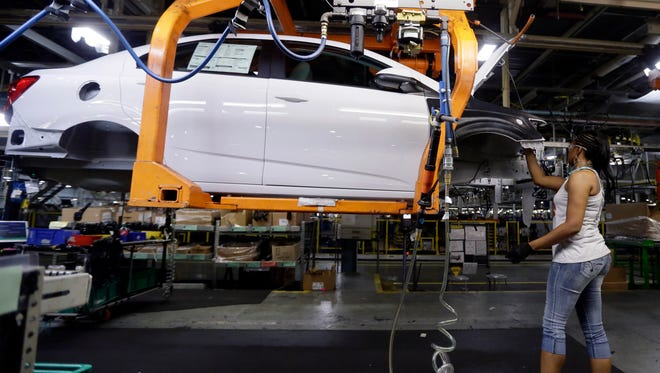 In this June 22, 2015 photo, a Buick Verano is assembled at General Motors' Orion Assembly plant in Orion Township,