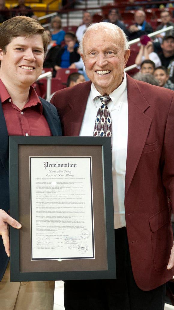Legendary NMSU basketball coach Lou Henson was presented
