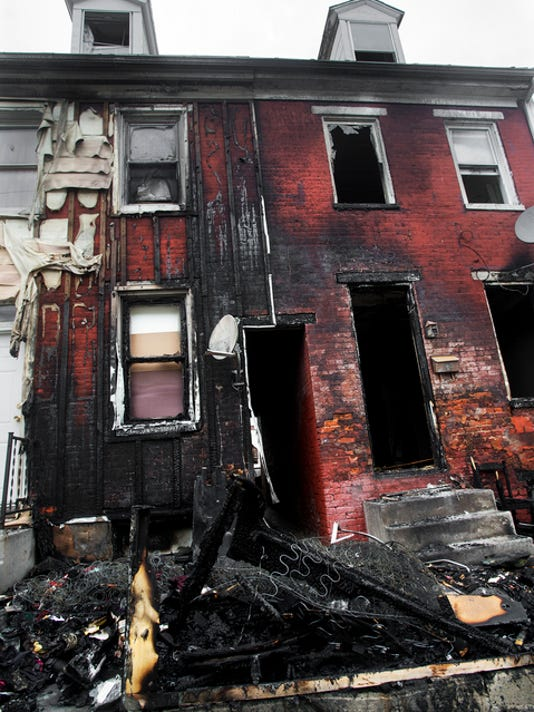 At least six people were displaced by a fire in the 300 block of Walnut Street in York Monday April 27, 2015. Officials said two adults and four children who were displaced by the fire were assisted with food and shelter.  Paul Kuehnel - Daily Record/Sunday News