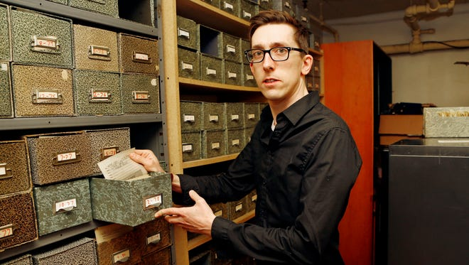 Journal & Courier's Thomas Maxfield in the photo archive room.
