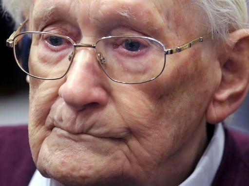 94-year-old former SS Sgt. Oskar Groening listens to