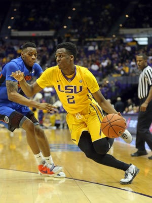 LSU Tigers guard Antonio Blakeney (2) moves around Florida Gators forward Justin Leon (24) in the second half of their game at the Pete Maravich Assembly Center.