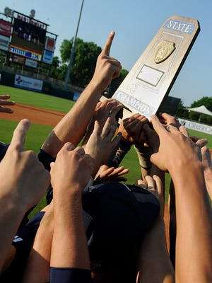 Trinity players celebrate after defeating Piedmont 12-0 in the second game of the AHSAA 3A state championship at Riverwalk Stadium in Montgomery, Ala., on May 16, 2012. (Montgomery Advertiser, Amanda Sowards)
