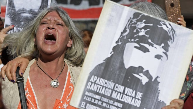 A woman shouts slogans while she holds a portrait of Santiago Maldonado, who disappeared on Aug. 1, 2017, during a Mapuche protest in Chubut province, during the Madres de Plaza de Mayo human rights organization weekly march, at Plaza de Mayo square in Buenos Aires on Sept. 14, 2017.