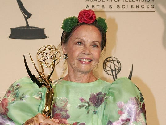 636026395606773090-1.-Leslie-Caron-with-Emmy-at-the-2007-ceremony.jpg