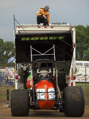 Austin Hogue of Manchester prepares his trailers viewing area at Williams Grove Speedway.   The first race for PA Sprint Car Speedweek was rained out after the hot laps June 24, 2016.