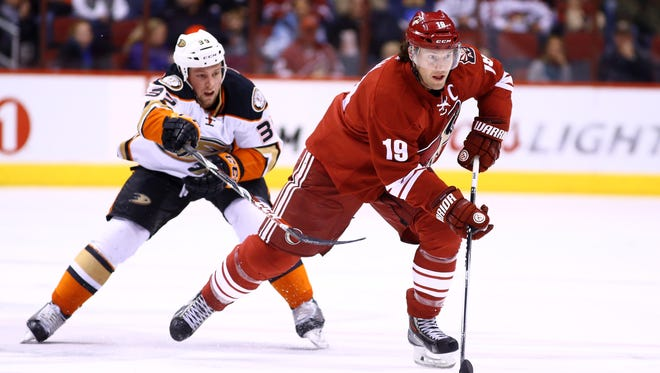 Arizona Coyotes right wing Shane Doan (19) moves the puck against the Anaheim Ducks in the second period at Gila River Arena in Glendale on Dec. 27.