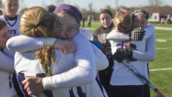 Rumson's Madison Maguire hugs Makenna Maguire after they win their state title over Madison. Madison vs Rumson-Fair Haven NJSIAA  Field Hockey Group II Finals in Bordentown, NJ on November 145,  2014. Peter Ackerman /Staff Photographer