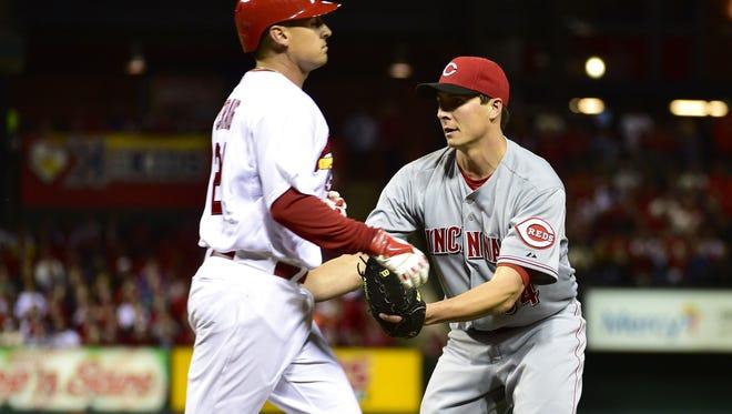 Reds starting pitcher Homer Bailey tags out Cardinals right fielder Allen Craig on April 8 at Busch Stadium.