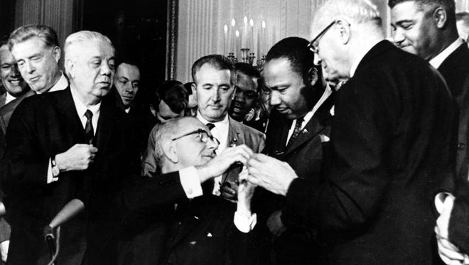 President Johnson shakes hands with Martin Luther King in 1964.