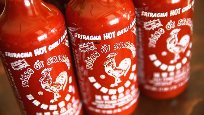 Bottles of Sriracha hot chili sauce