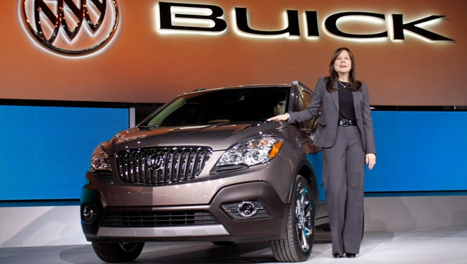 Mary Barra introduces the 2013 Buick Encore during a press preview at the North American International Auto Show on Jan. 10, 2012, in Detroit.