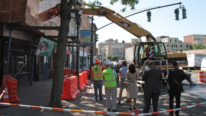 Yonkers Mayor Mike Spano, along with state Sen. Andrea Stewart-Cousins, begin the demolition of the storefront at 24 Warburton Ave., clearing the way for the second phase of the daylighting of the Saw Mill River.