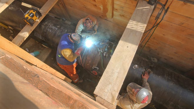 Workers weld sections of a new 36-inch gas transmission line being installed on S. 9th Ave. in Mount Vernon Sept. 19, 2014. Con Edison is replacing an old 24-inch transmission line the runs from the Bronx to White Plains.
