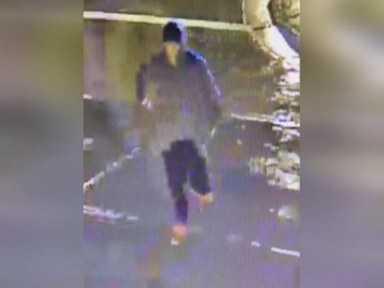 Marathon County Crime Stoppers is asking for your help to identify a male suspect vandalizing property in downtown Wausau. As pictured, a suspect was observed on video surveillance committing this crime. He is described as wearing a distinguishing pair of red sneakers, dark pants with tight cuffs at the ankles, black baseball hat, grey hoodie, brown jacket, and glasses.