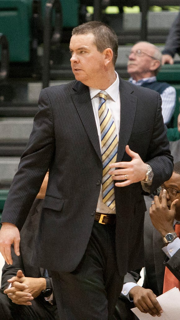 Binghamton men's basketball coach Tommy Dempsey paces the sidelines in the Events Center.