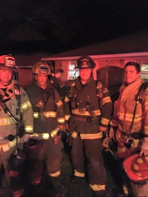 Bossier firefighters Bryan Hester (second from left) and Dalton Elliott (third from left) with Central  firefighters Donnie McDonald (left) and Jordy Byrd (right).