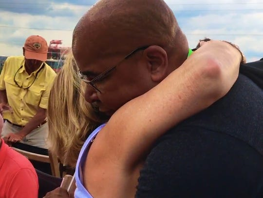 """Big Dave"" Sylvester hugs a woman on his tour across"