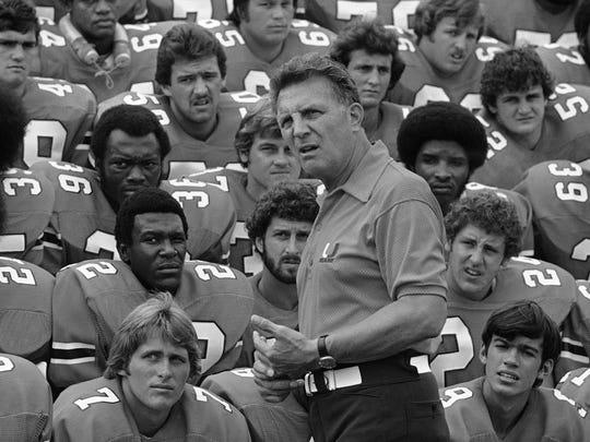 Head coach Lou Saban talks to his Hurricanes on Aug. 16, 1977.