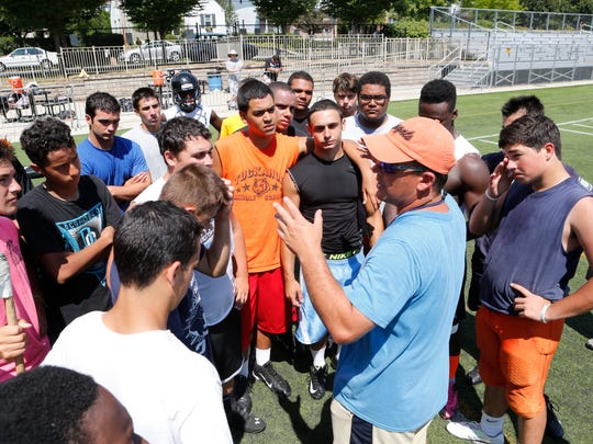 Pat Gallo, assistant coach of the Tuckahoe High School football, team talks to members during practice.