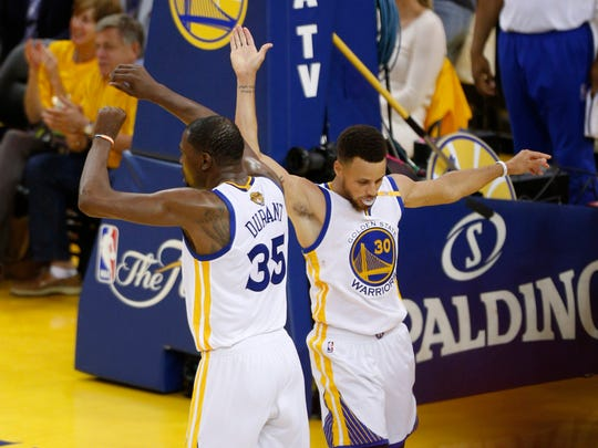 Jun 4, 2017; Oakland, CA, USA; Golden State Warriors guard Stephen Curry (30) celebrates with forward Kevin Durant (35) against the Cleveland Cavaliers during the second half in game two of the 2017 NBA Finals at Oracle Arena. Mandatory Credit: Cary Edmondson-USA TODAY Sports usp ORG XMIT: USATSI-359434 [Via MerlinFTP Drop]