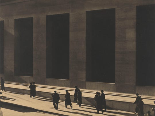 Wall Street in 1915 as captured by the lens of Paul Strand. A collection of his photos is on display the Philadelphia Museum of Art.
