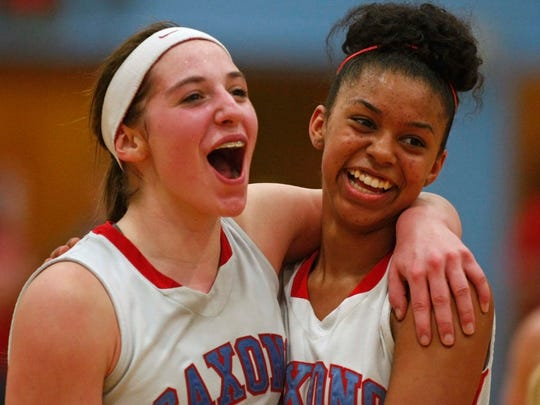 South Salem's Jordan Woodvine, left, and Evina Westbrook celebrate as time runs out on the Saxons' 62-44 victory over West Linn on March 7 in the second round of OSAA 6A basketball playoffs.