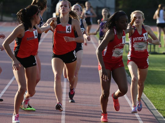 North Rockland's Katelyn Tuohy hands the baton off to her teammate Camille Cameron in the Women's East Coast DMR on day 1 of the Loucks Games at White Plains High School May 12, 2016.
