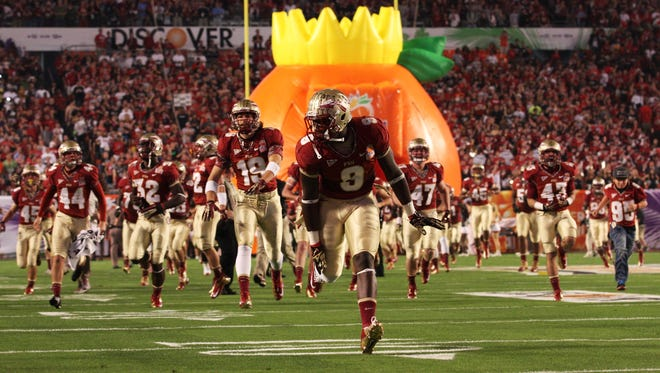 Karlos Williams (9) takes the field alongside his teammates prior to defeating NIU in the 2013 Discover Orange Bowl on January 1.