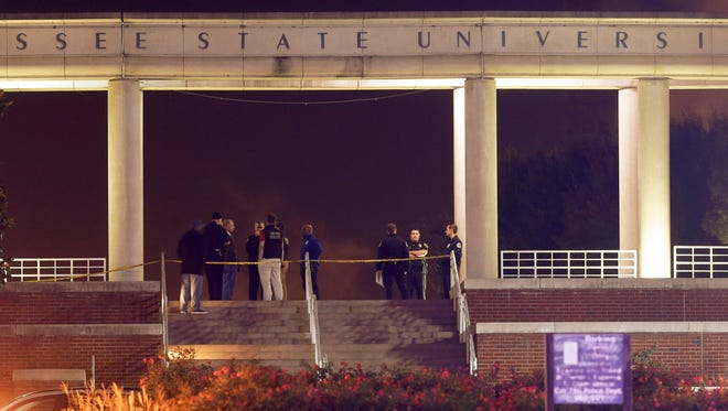 Officials investigate the scene of a shooting on the campus of Tennessee State University, early Friday, Oct. 23, 2015, in Nashville, Tenn. Authorities say one person was killed and three others injured.