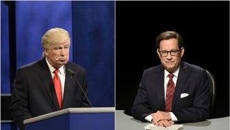 Donald Trump (Alec Baldwin) faces debate moderator Chris Wallace (Tom Hanks) on 'Saturday Night Live.'