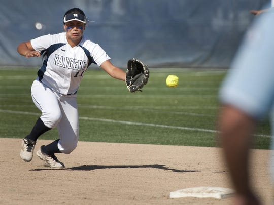 Redwood's Makailah Hernandez makes a stop on a hit