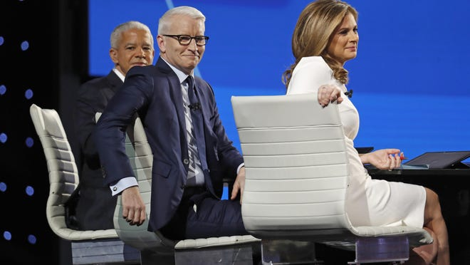 Marc Lacey, New York Times national editor, from left, Anderson Cooper, CNN anchor, and Erin Burnett, CNN anchor, wait for the start of a Democratic presidential primary debate in Ohio
