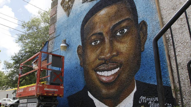 A mural depicting Ahmaud Arbery in Brunswick, Ga., where the 25-year-old man was shot and killed in February. The state's citizen's arrest law became a focus of attention following Arbery's death.