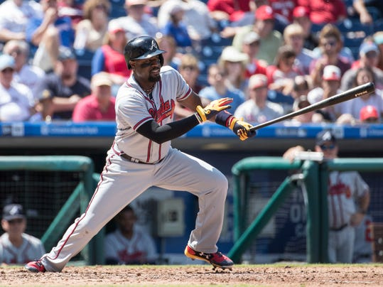 Atlanta Braves' Brandon Phillips puts the ball in play during the fifth inning of the first baseball game of a doubleheader against the Philadelphia Phillies, Wednesday, Aug. 30, 2017, in Philadelphia. (AP Photo/Chris Szagola)
