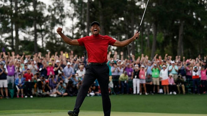 From April 14, 2019, Tiger Woods reacts as he wins the Masters golf tournament in Augusta, Ga. Augusta National decided Friday, March 13, 2020, to postpone the Masters because of the spread of the coronavirus. Club chairman Fred Ridley says he hopes postponing the event puts Augusta National in the best position to host the Masters and its other two events at some later date. Ridley did not say when it would be held.