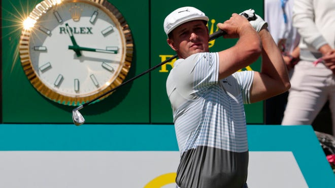Bryson DeChambeau of the United States follows his tee off at the tenth hole during the second round for the WGC-Mexico Championship golf tournament, at the Chapultepec Golf Club in Mexico City, Friday, Feb. 21, 2020.